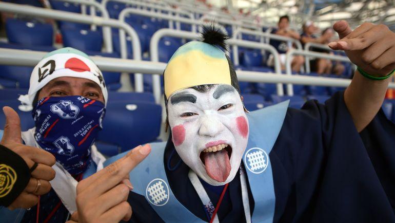 Колоритные японские болельщики на матчах своей национальной команды в России. Фото Reuters