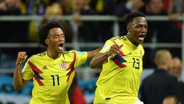 Вторник. Москва. Тушино. Колумбия - Англия - 1:1, пенальти - 3:4. Йерри МИНА (справа) празднует забитый мяч.