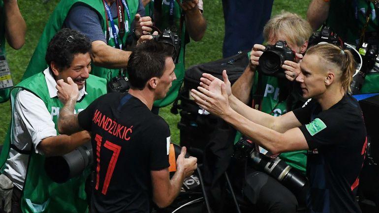 Юрий КОРТЕС и хорваты. Фото AFP