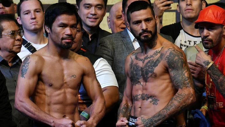 14 июля. Куала-Лумпур. Мэнни ПАКИАО и Лукас МАТИССЕ. Фото Reuters