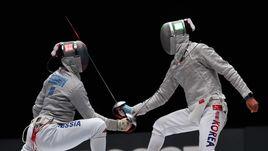 22 июля. Уси. Камиль ИБРАГИМОВ (слева) против корейца Ким ЧЖУНХВАНА.