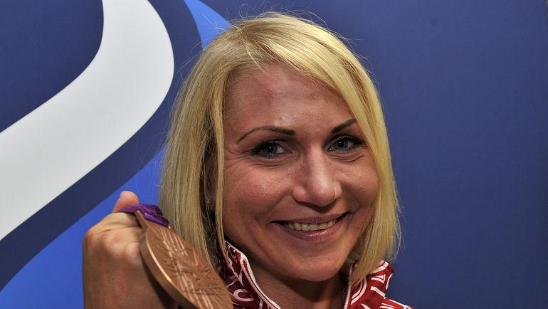 Ольга ЗАБЕЛИНСКАЯ с медалью Игр-2012 в Лондоне. Фото Алексей ИВАНОВ