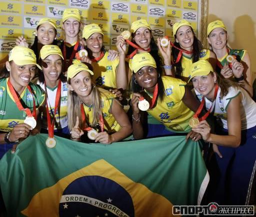 Волейболистки сборной Бразилии с золотыми медалями Олимпиады. Фото REUTERS.