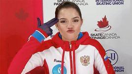 26 октября. Лаваль. Жест Евгении Медведевой после короткой программы.