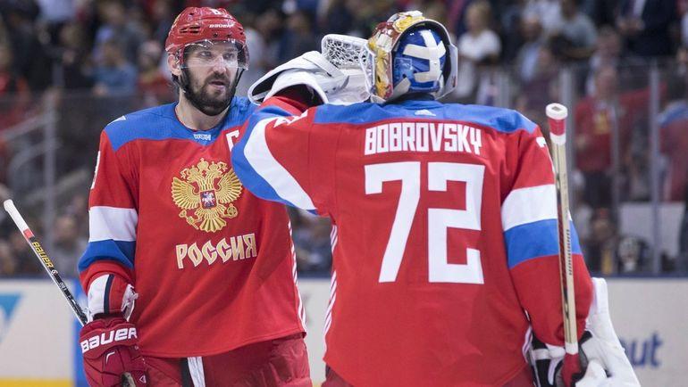 Александр Овечкин (слева) и Сергей Бобровский. Фото AFP
