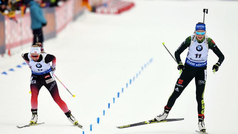 20 января. Рупольдинг. Франциска Пройсс (справа) на финише опережает Ингрид Таннреволь. Фото AFP