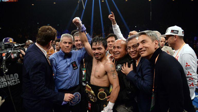 19 января. Лас-Вегас. Мэнни Пакиао празднует победу. Фото AFP