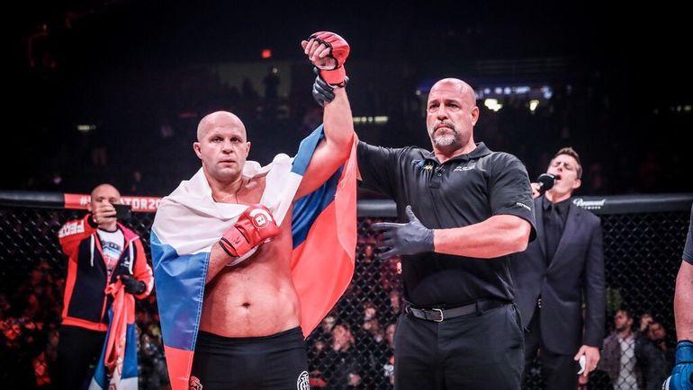 Федор Емельяненко (слева) никогда не будет выступать в UFC? Фото twitter.com/TennisAusGIG
