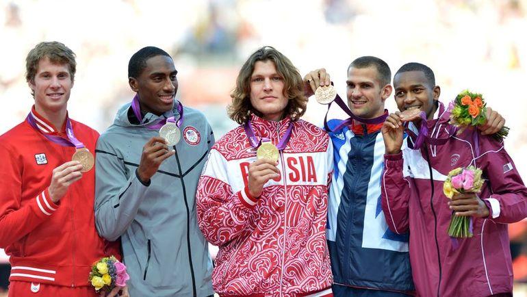 Иван Ухов (в центре) обвинен в нарушении антидопинговых правил и будет лишет золота Олимпийских игр. Фото AFP
