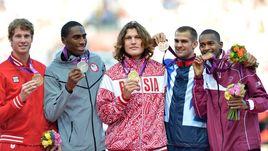Иван Ухов (в центре) обвинен в нарушении антидопинговых правил и будет лишет золота Олимпийских игр.