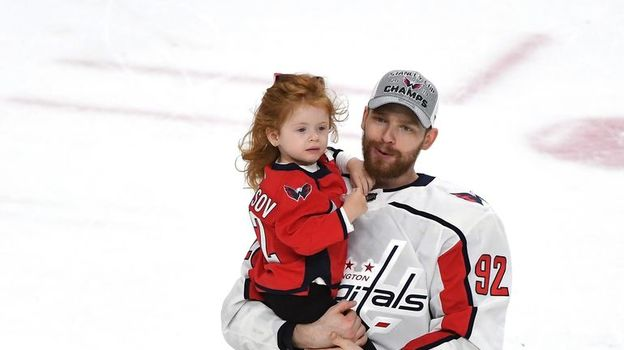 Евгений Кузнецов с дочерью. Фото AFP