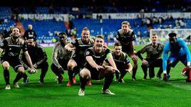 """5 марта. Мадрид. """"Реал"""" - """"Аякс"""" - 1:4. Капитан """"Аякса"""" Маттайс де Лигт (на переднем плане) и его партнеры празднуют победу над """"Реалом""""."""