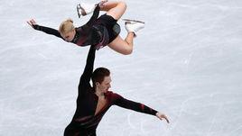 20 марта. Сайтама. Евгения Тарасова и Владимир Морозов установили мировой рекорд в короткой программе и захватили лидерство на чемпионате мира.