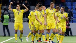 21 марта. Астана. Казахстан - Шотландия - 3:0. Футболисты казахской сборной празднуют забитый мяч.