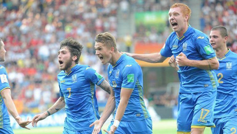 15 июня. Лодзь. Украина - Корея - 3:1. Украинские футболисты празднуют забитый мяч. Фото AFP