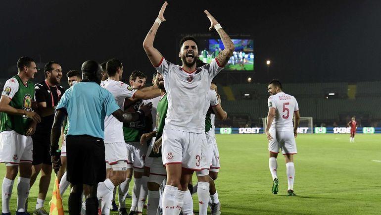 11 июля. Каир. Мадагаскар – Тунис – 0:3. Футболисты сборной Туниса празднуют победу в матче. Фото AFP