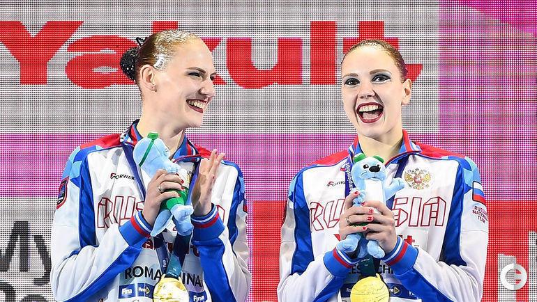 18 июля. Кванджу. Светлана Ромашина (слева) и Светлана Колесниченко на верхней ступеньке чемпионата мира.