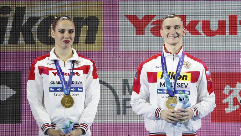 Майя Гурбанбердиева и Александр Мальцев. Фото Reuters