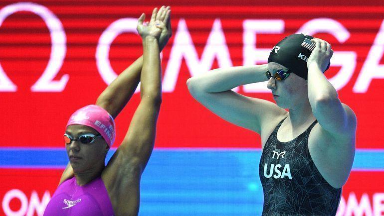 23 июля. Кванджу. Юлия Ефимова (слева) и Лилли Кинг перед стартом 100-метровки. Фото AFP