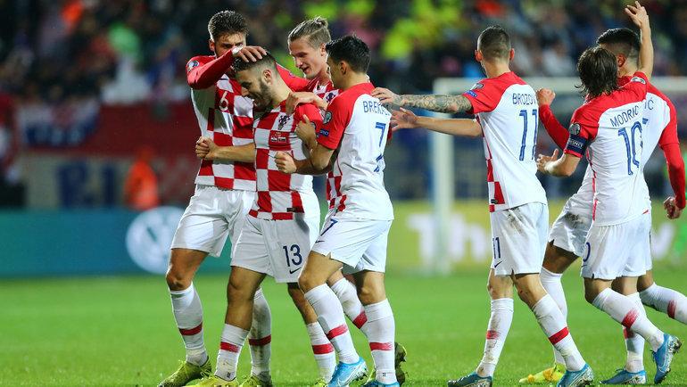 16ноября. Риека. Хорватия— Словакия— 3:1. Радость Николы Влашича (№13) иего партнеров после гола. Фото Reuters