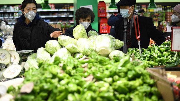 Напродуктовом рынке Пекина. Фото AFP