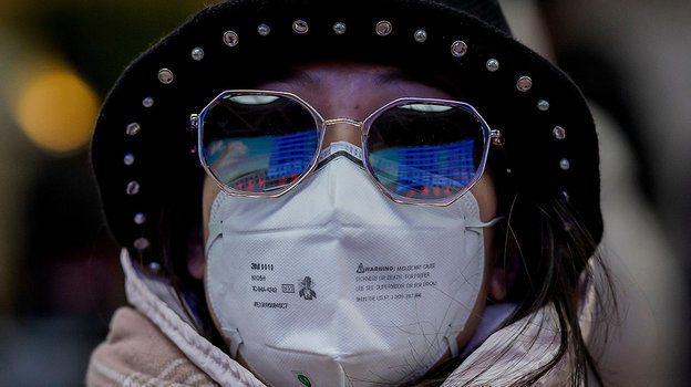 Население обязывают носить маски для профилактики борьбы скоронавирусом. Фото AFP