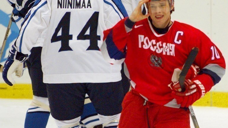 Павел Буре вматче сФинляндией. Фото Reuters