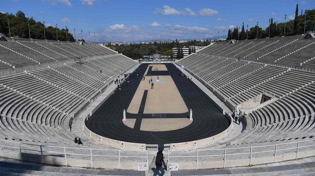 19марта. Афины. Построенный вантичные времена греческий стадион Панатинаикос, накотором в1896 году были проведены первые всовременной истории Олимпийские игры, впервые был пуст наподобной церемонии..