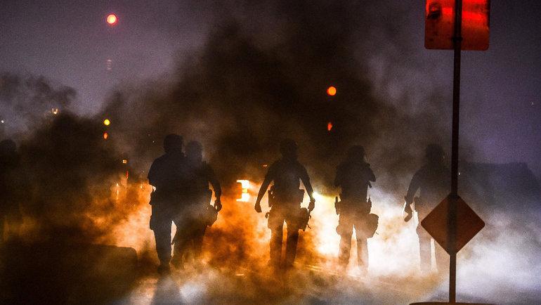 Беспорядки вМиннесоте из-за убийства афроамериканца полицейским. Фото AFP