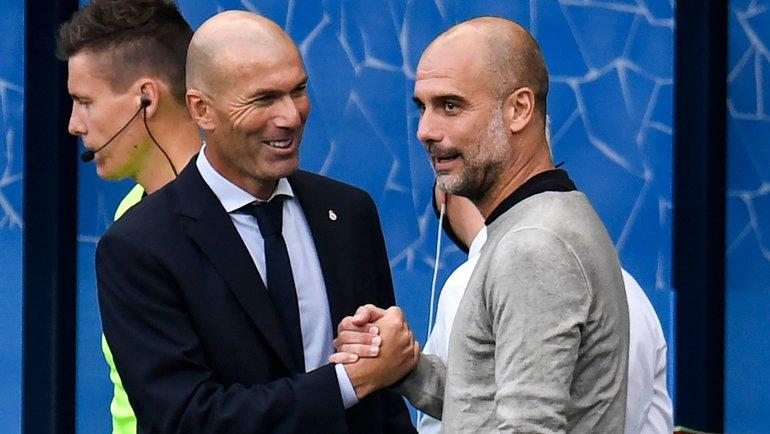 7августа. Манчестер. «Манчестер Сити»— «Реал»— 2:1. Хосеп Гвардьола (справа) иЗинедин Зидан. Фото AFP