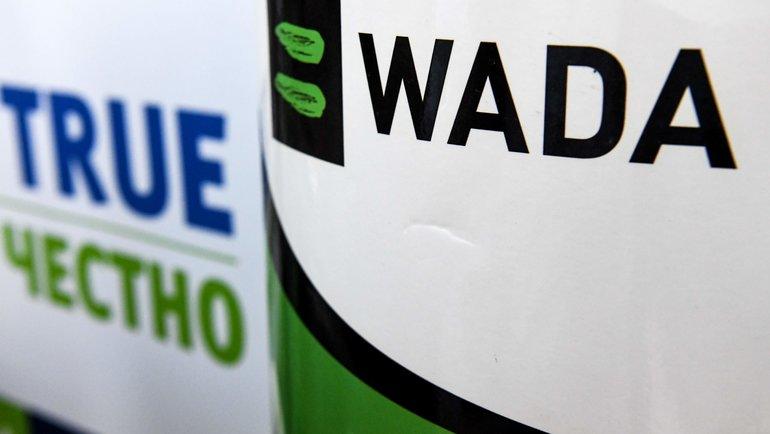 Лого WADA и слоган на русском языке. Фото AFP