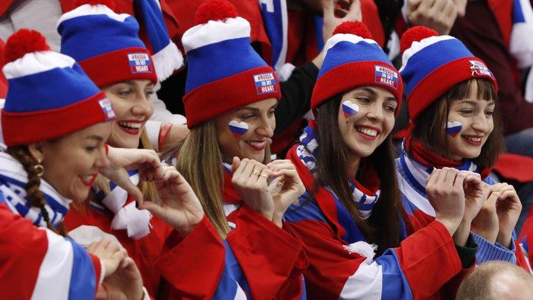 Россия— вмоем сердце: девиз болельщиков испортсменов наОлимпиаде-2018, которую сборная провела внейтральном статусе. Фото AFP