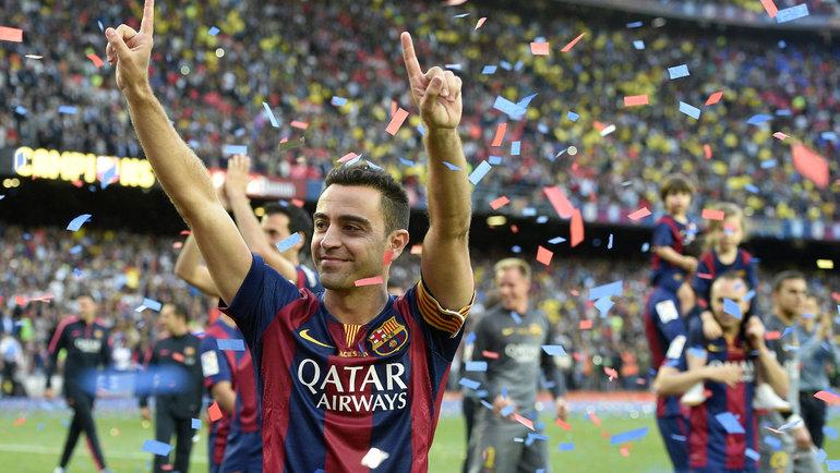 Хави вовремя выступления за «Барселону». Фото Reuters