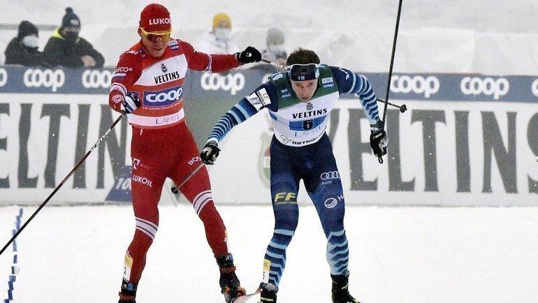 Александр Большунов иЙони Мяки. Фото AFP