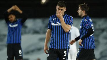16марта. Мадрид. «Реал»— «Аталанта»— 3:1. Йоаким Мехле иАлексей Миранчук (справа) после матча.