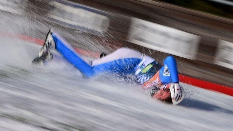 Даниэль-Андре Танде потерял сознание после неудачного приземления на разминке на этапе Кубка мира. Фото AFP