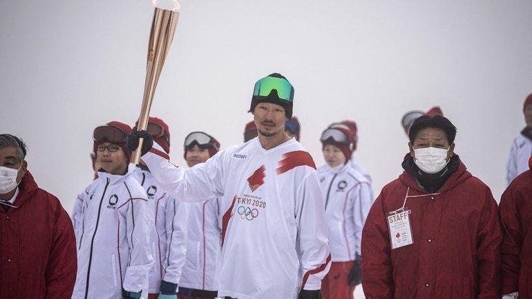 Эстафета олимпийского огня вЯпонии. Фото AFP