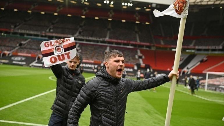 Болельщики «МЮ» настадионе «Олд Траффорд». Фото AFP