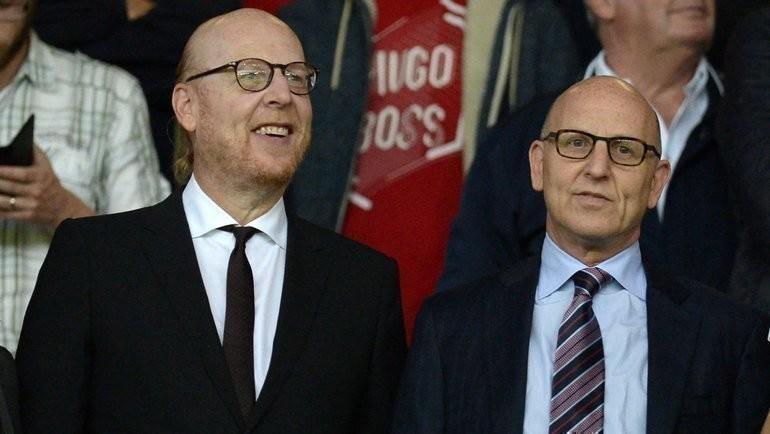 Джоэль Глейзер (справа). Фото AFP