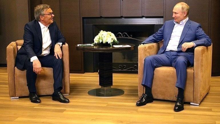 Рене Фазель иВладимир Путин. Фото kremlin.ru