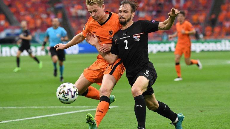 Голландия— Австрия. Френки деЙонг против Андреаса Ульмера. Фото AFP