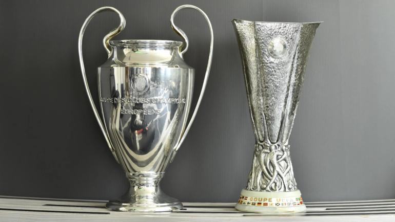Трофеи Лиги чемпионов иЛиги Европы УЕФА. Фото UEFA.com