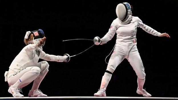 24июля. Токио. Айзанат Муртазаева (справа). Фото AFP