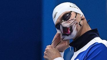 Евгений Рылов вфирменной маске скотом.