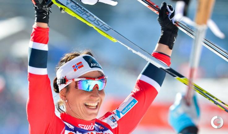 Норвежская лыжница Марит БЬОРГЕН отмечает победу. Фото AFP.
