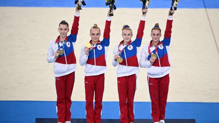 Лилия Ахаимова, Ангелина Мельникова, Виктория Листунова иВладислава Уразова— золото вкомандном турнире гимнасток! Фото AFP