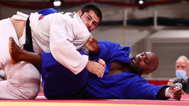 Тамерлан Башаев иТедди Ринер. Фото AFP
