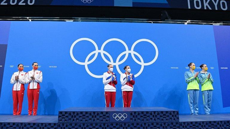 Синхронистки Светлана Колесниченко иСветлана Ромашина выиграли золото Токио-2020 втурнире дуэтов. Фото AFP