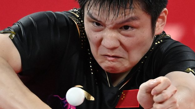 Сборная Китая выиграла золото Олимпиады внастольном теннисе вмужском командном разряде. Фото AFP