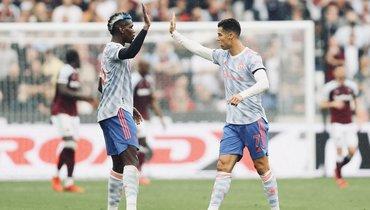 Криштиану Роналду (справа). Фото ФК «Манчестер Юнайтед».